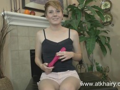 Redhead Nico Sweet fucks her hairy pussy with a toy
