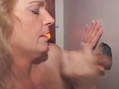 Blonde Takes Cumshot On Tits Through Glory Hole