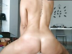 Blonde woman with tattoos rides hard a plastic dildo live on a cam
