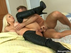 Busty blonde Candy Manson wears leather stockings to seduce her man